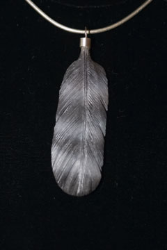 Peregrine falcon feather carving