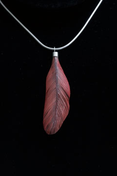 Northern cardinal feather carving